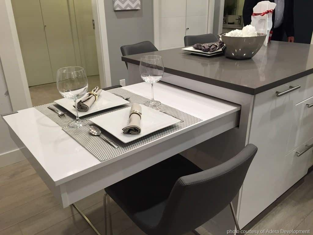 A Kitchen Island With A Pull Out Dining Table Modern Kitchen Island Kitchen Island Countertop Kitchen Island Table Combination