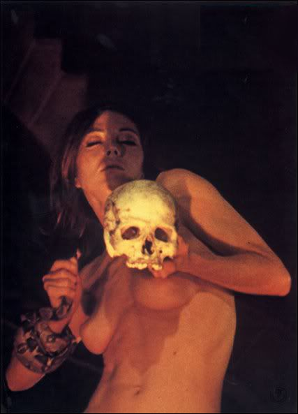 impact-naked-woman-holding-skull-oral-sex-position