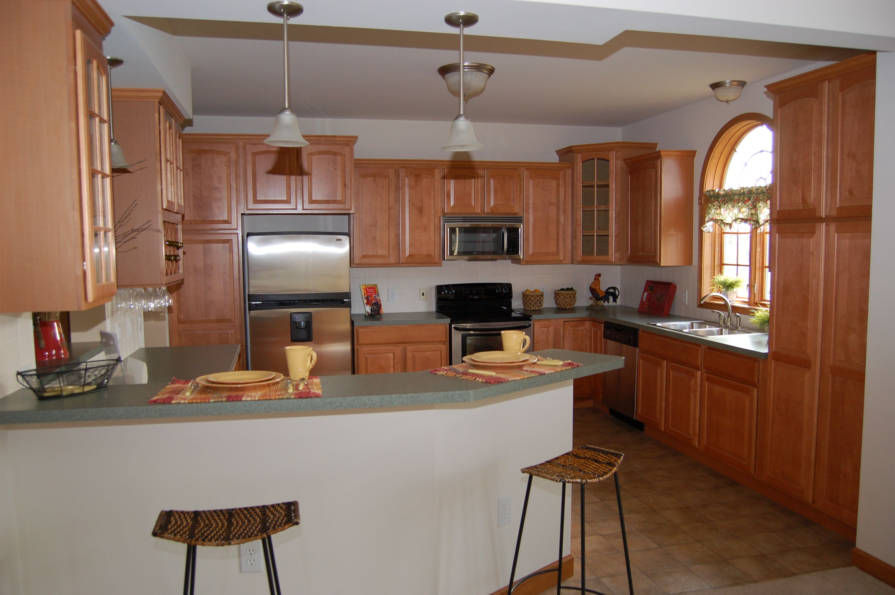 Beautiful modular home kitchen with merillat cabinets for Kitchen cabinets zeeland mi