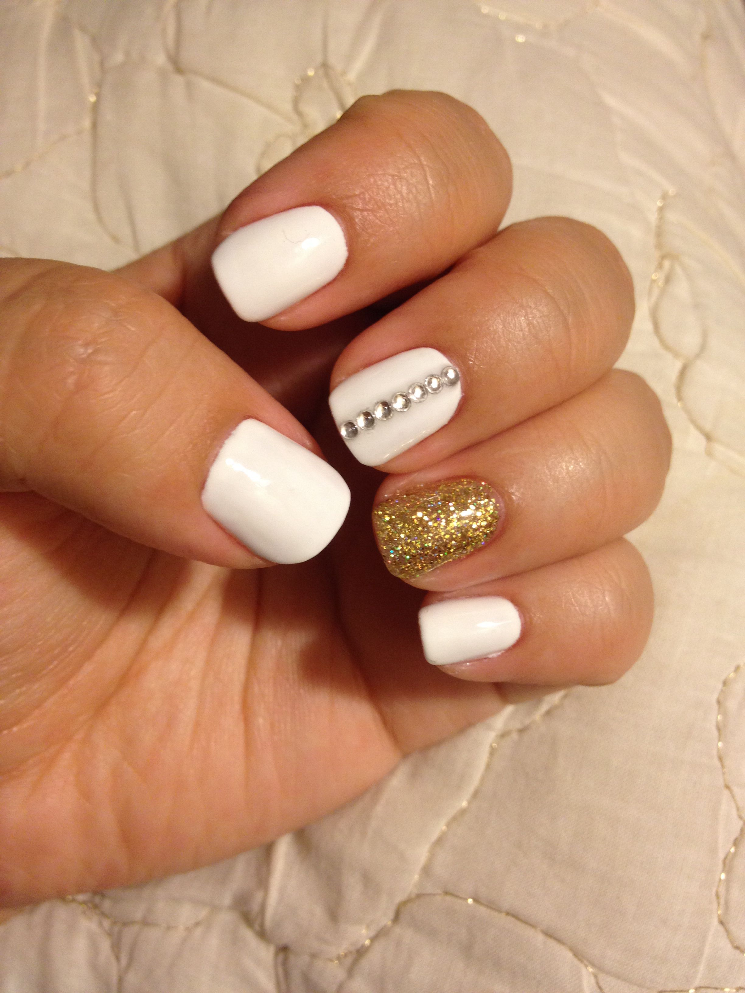 My White Nails With Gold Glitter Accent Nail And Rhinestones