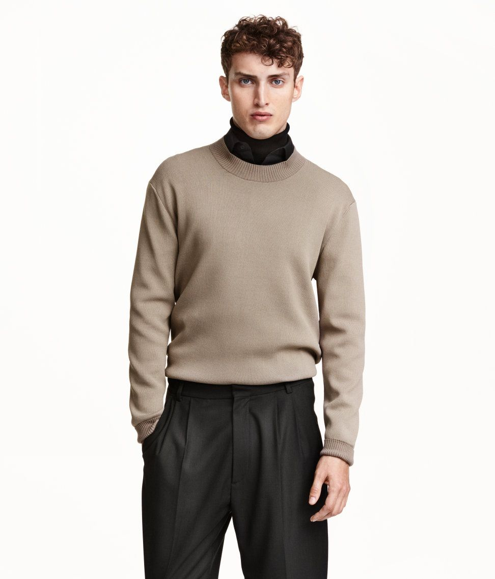 Men's collection AW15. Sweater in a fine rib knit with a slight sheen. Slightly dropped shoulders, long sleeves, and chunky ribbing at neckline, cuffs, and hem.