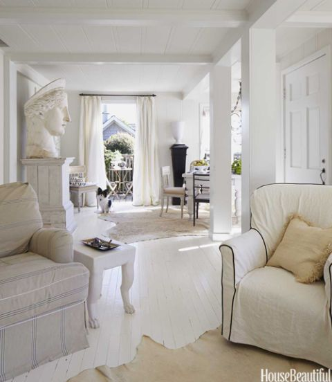 """""""French vanilla"""" colour scheme. Paint everything white to open it up and make it feel airy. Interior columns create the effect of an enfilade toward the balcony, glimpsed between curtains."""