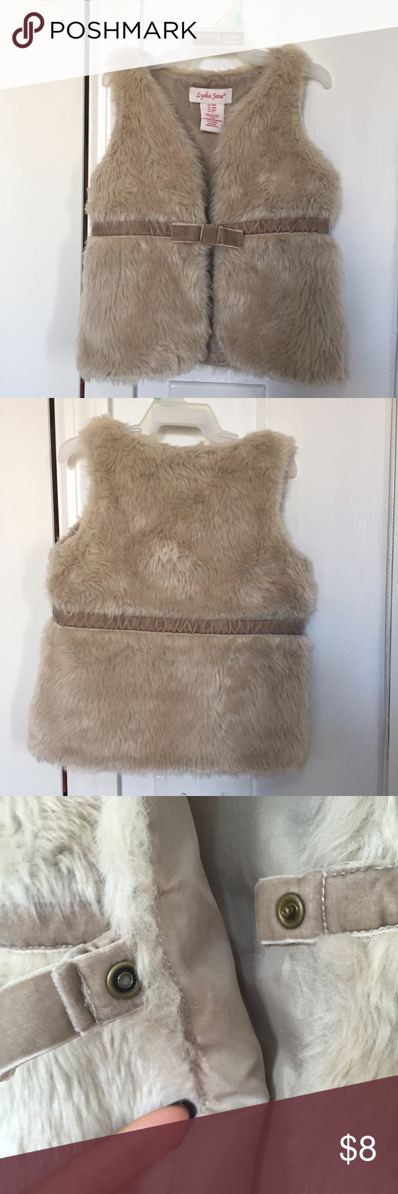 Tan Furry Vest for toddlers This super cute tan furry best has a velvety belt detail and bow snap closure as seen in the picture. Jackets & Coats Vests