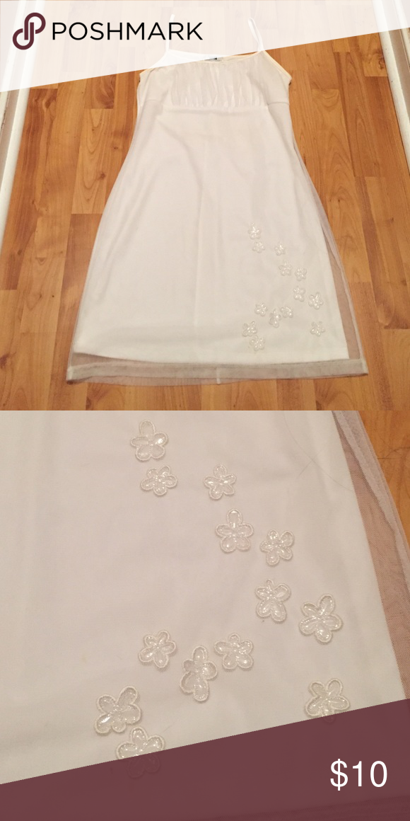 Beautiful white dress White cocktail dress, only worn once. Great for a social function, wedding or graduation.  Size says large (its juniors) but I think it runs small. Brand is Candy Rocket Dresses Midi