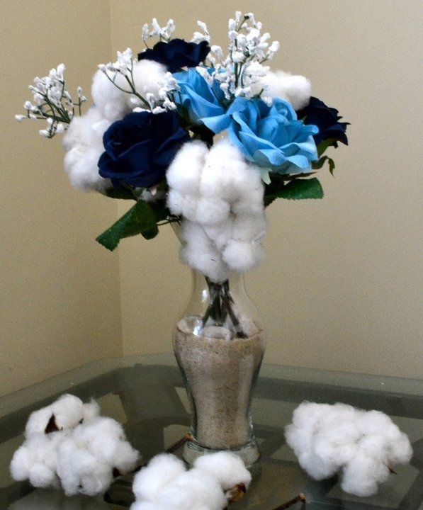 Faux floral centerpiece using fabric flowers and cotton.