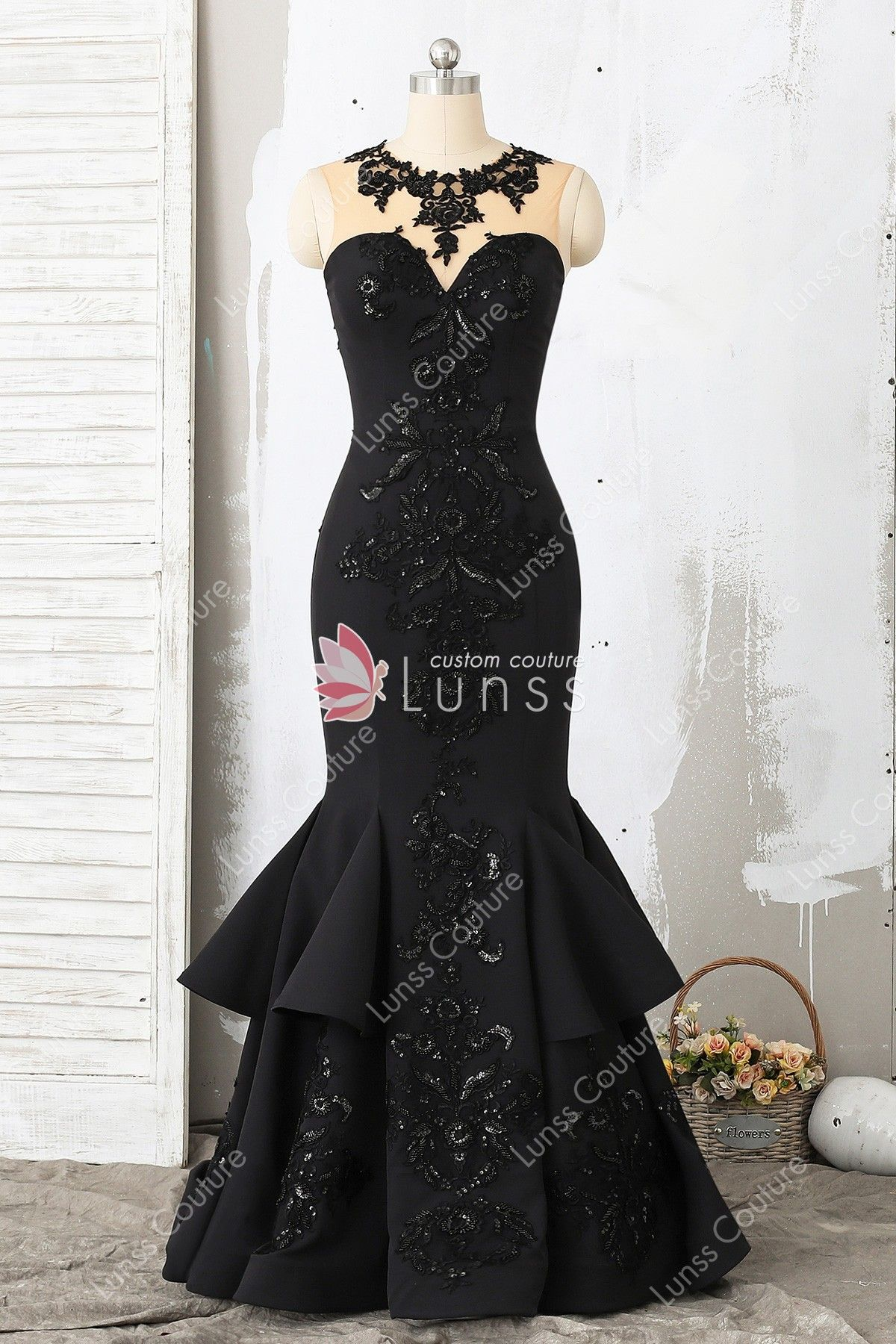 ad38d320a057b9 This classic black satin sleeveless floor length trumpet prom dress  features illusion neck bodice decorated with