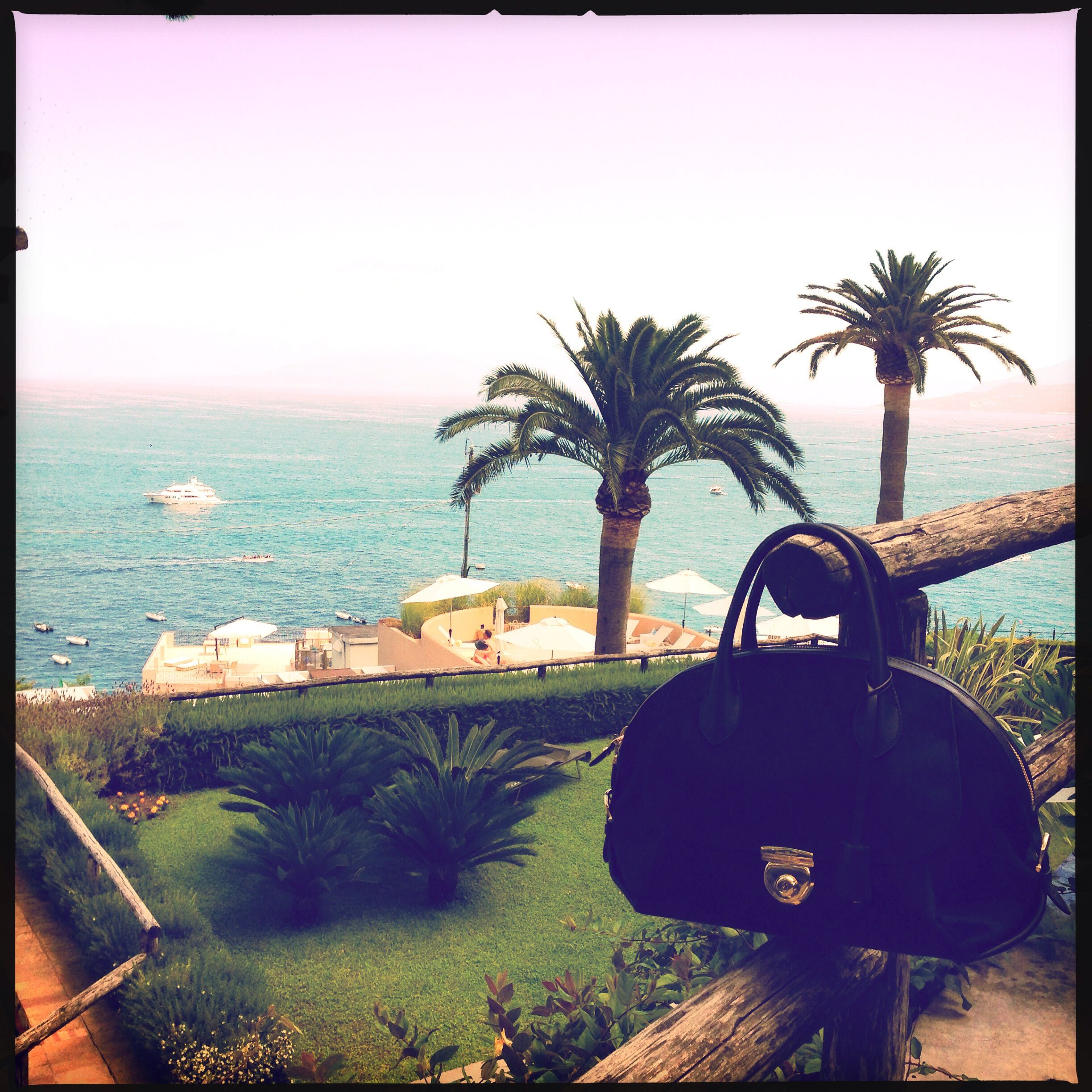 #theFiamma #SummerHoliday with Nausheen Shah in the French Riviera. Shop the Fiamma handbag at www.ferragamo.com