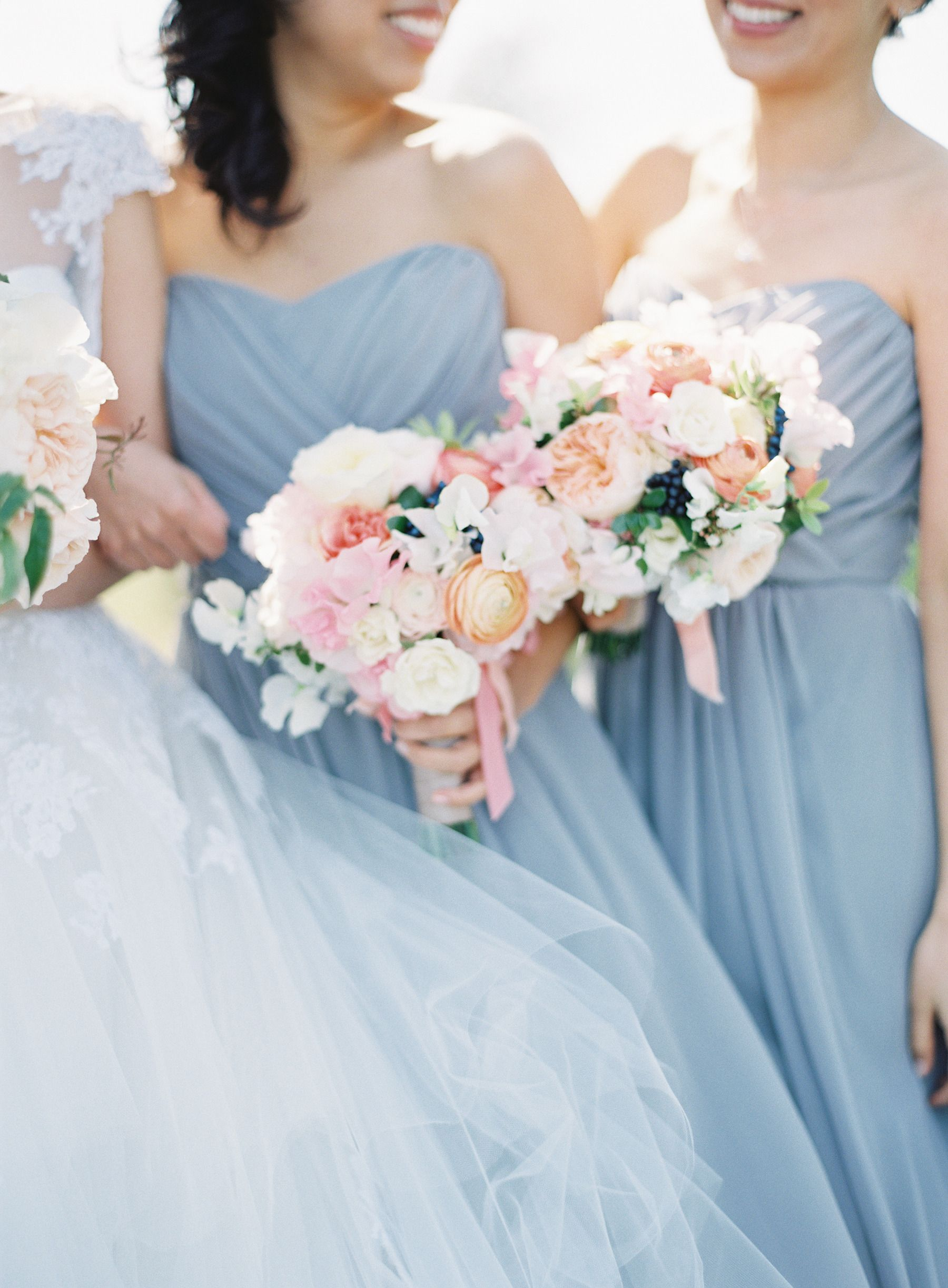 powder blue bridesmaids and pink and peach blooms | Photography: Kurt Boomer Photography - kurtboomerphoto.com Read More: http://www.stylemepretty.com/2014/09/16/romantic-hillside-wedding-in-san-clemente/