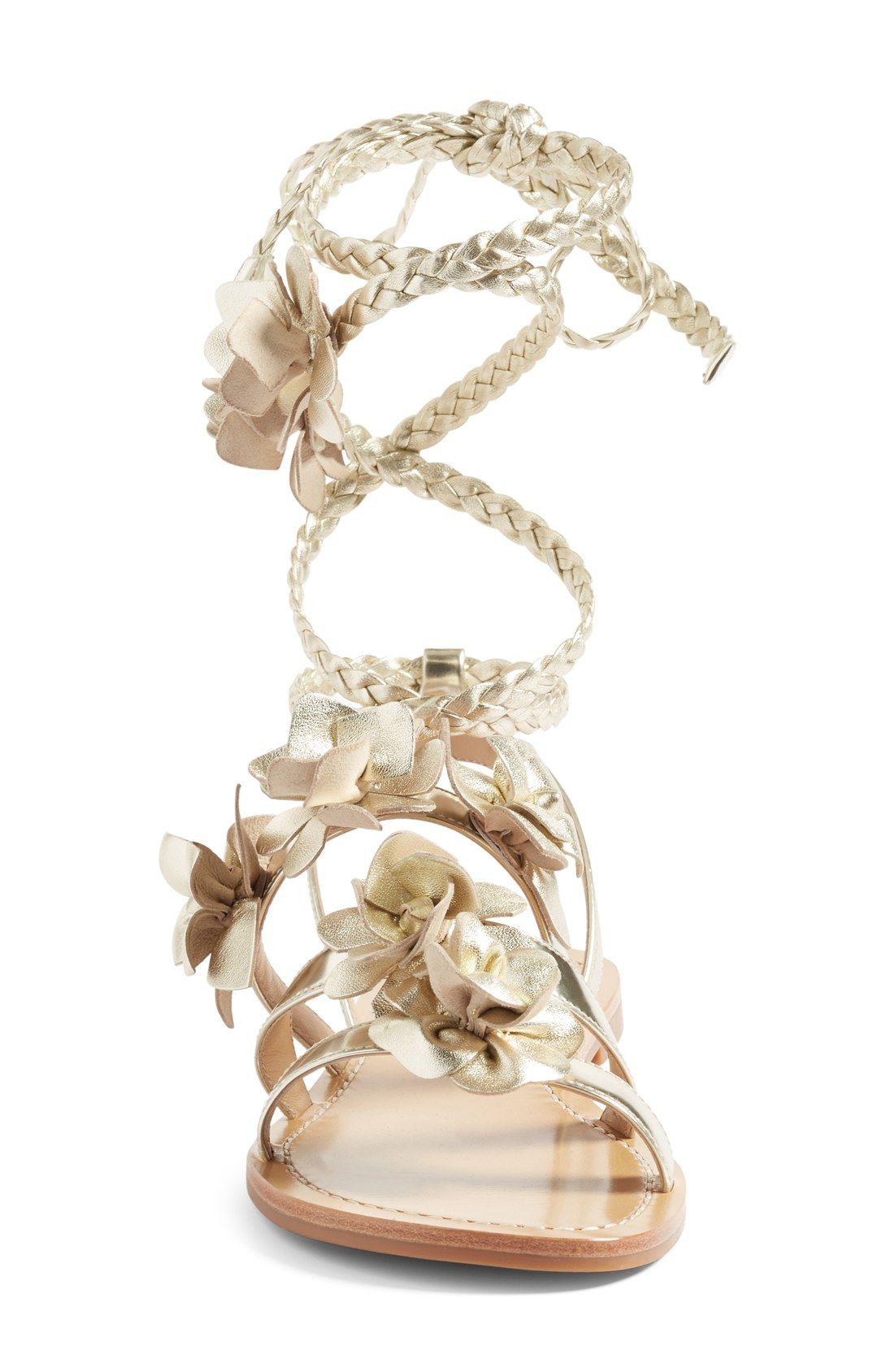 4abe37066354d Free shipping and returns on Tory Burch Blossom Gladiator Sandal (Women) at  Nordstrom.com. Fierce meets feminine on this stunning metallic gladiator  sandal ...