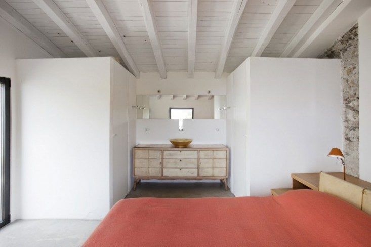 A whitewashed italian farmhouse with just a dash of color