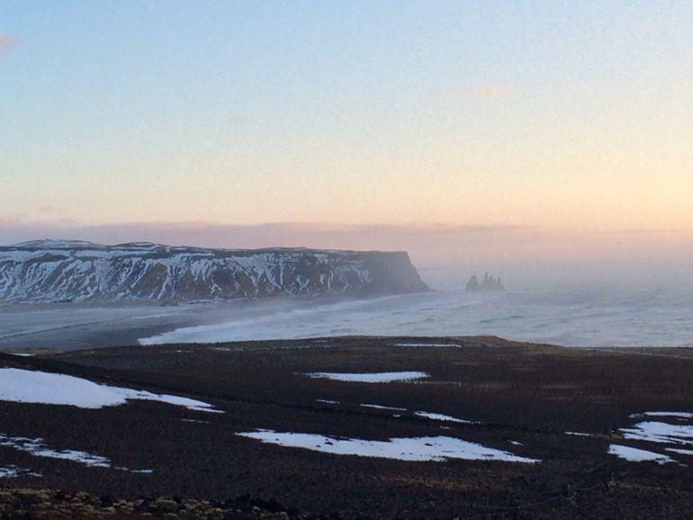 Iceland Dyrholaey black sand beach view toward Vik