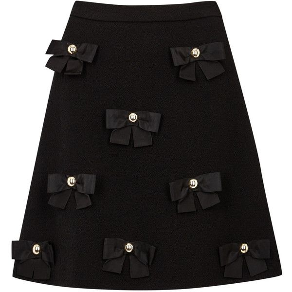 Boutique Moschino Black Bow-embellished Wool Blend Skirt - Size 6 (650 CAD) ❤ liked on Polyvore featuring skirts, bow skirt, boutique moschino, wool blend skirt and studded skirt
