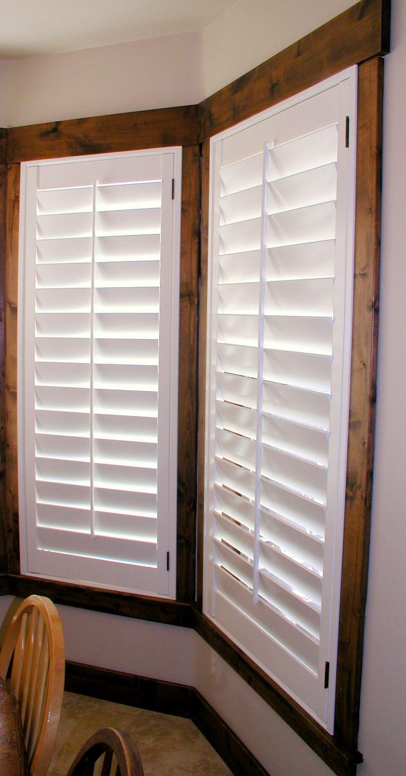 Dark trim white plantation shutters