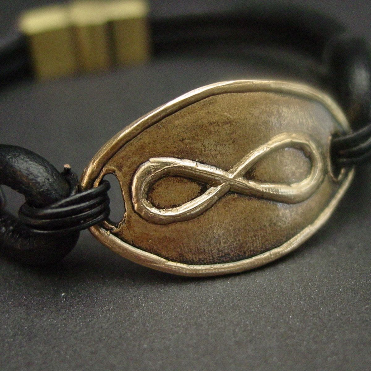 Large infinity symbol leather bracelet hand carved by french artist