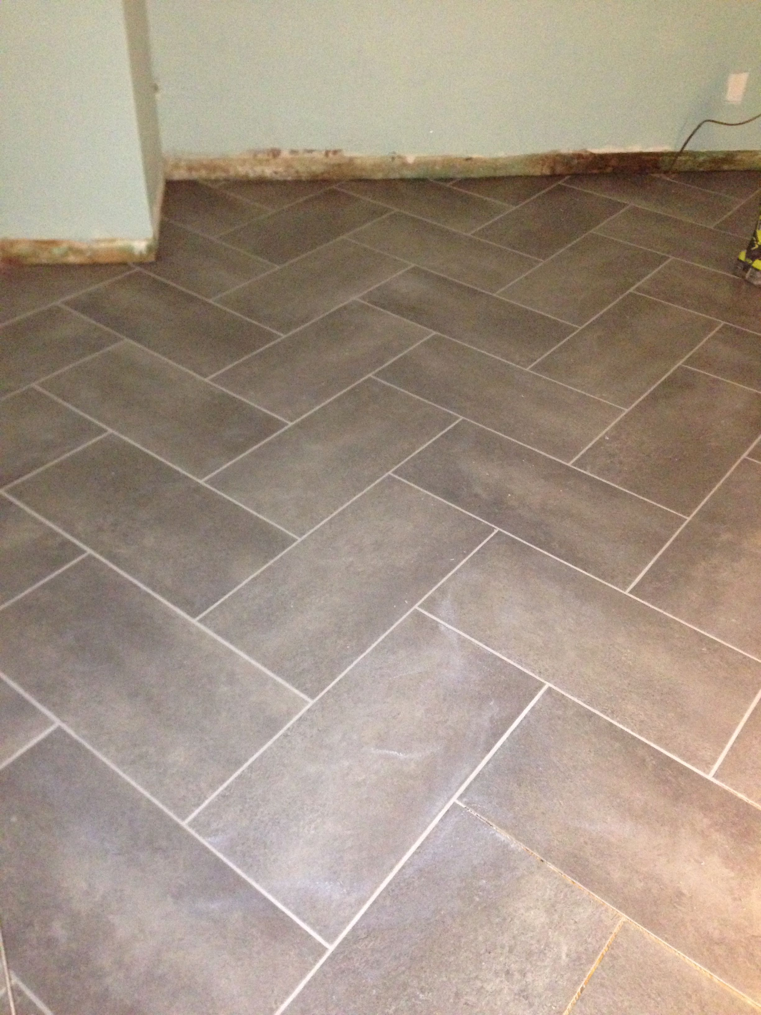 Trafficmaster ceramica 12x24 coastal gray herringbone pattern peel trafficmaster ceramica 12x24 coastal gray herringbone pattern peel and stick with grout dailygadgetfo Image collections