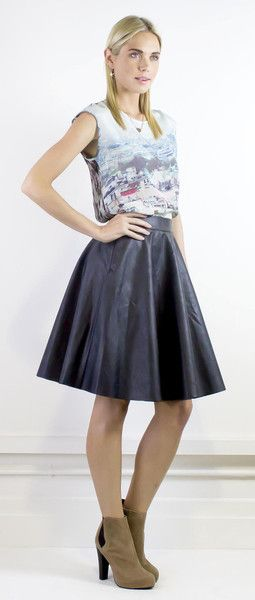 Cool outfit of Paris print on silk top and a  black leather skirt