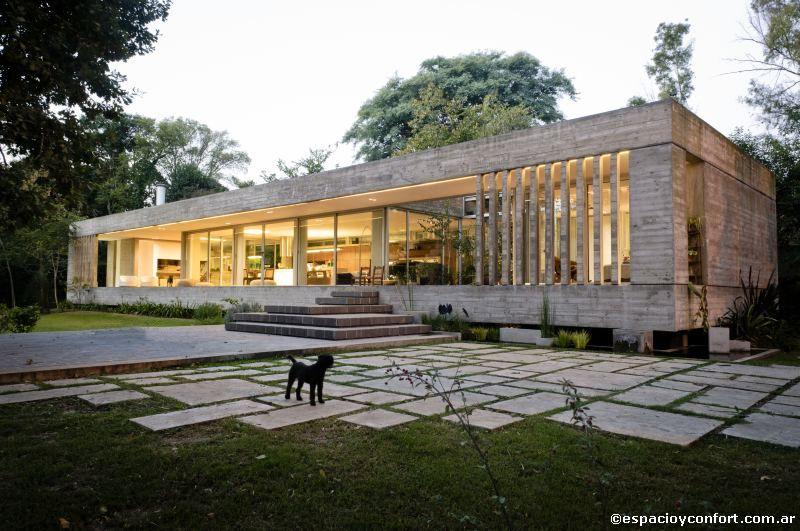 Arquitectura inteligente la fachada ocupada y permitiendo for Casas modernas hormigon visto