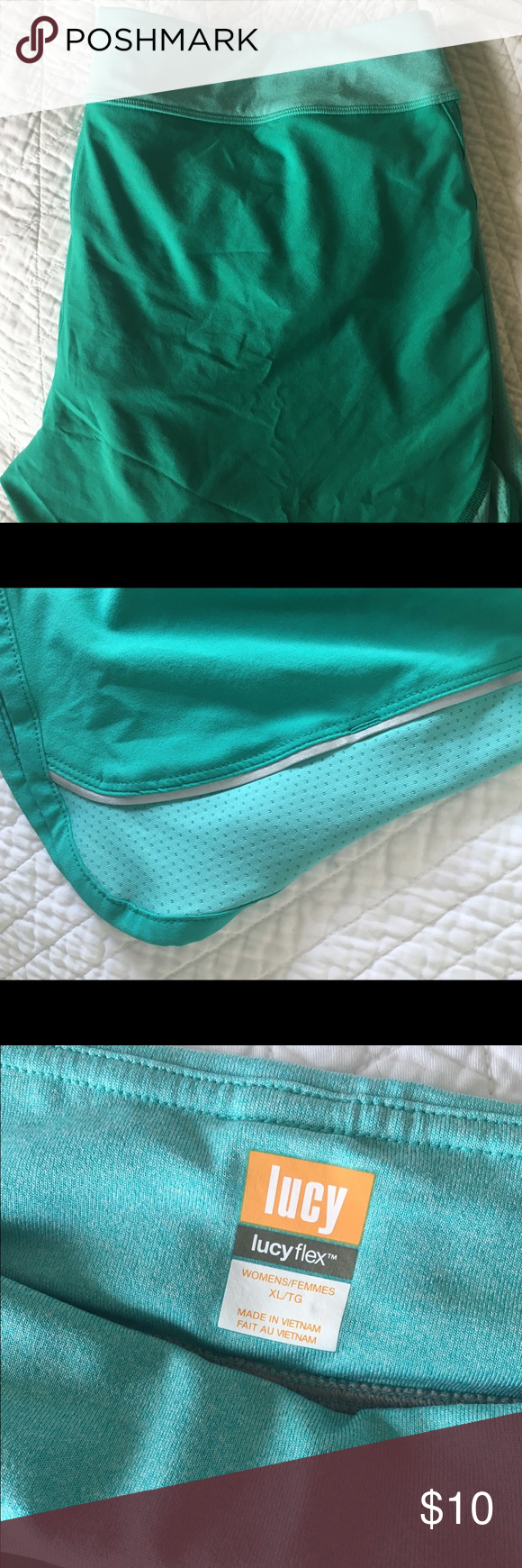 Lucy Lined Running Shorts in Teal Never worn. Lucy Shorts