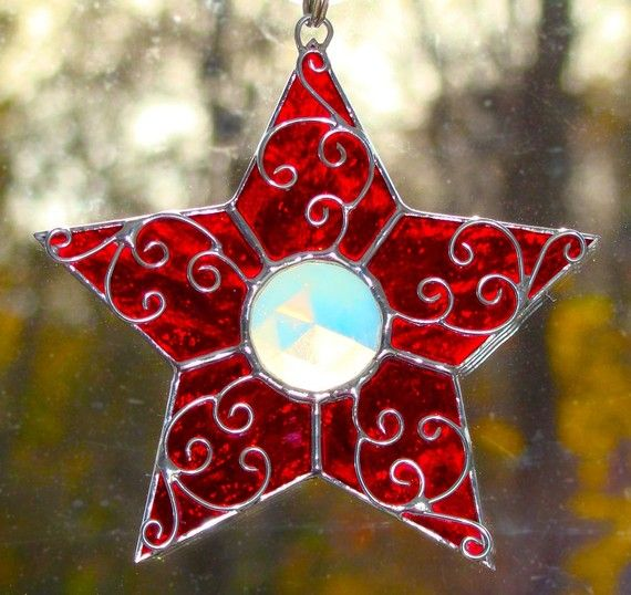 This stained glass star is a great size for a Christmas ornament but would be just as eye catching hanging in a window.    It is made with the