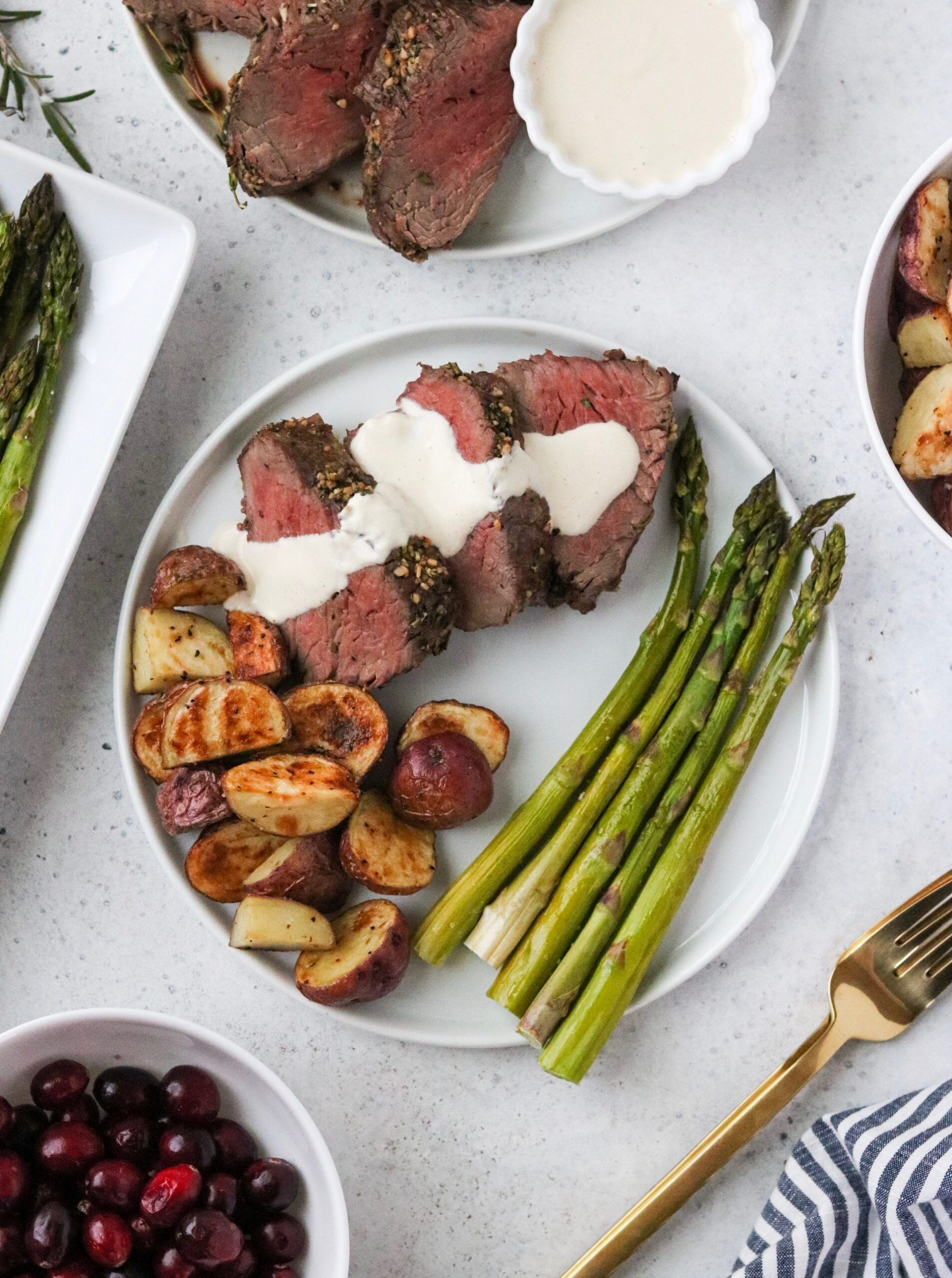 This Beef Tenderloin with Dairy Free Horseradish Sauce is the perfect meal to serve at all of your holiday gatherings! This is a fool-proof method for cooking tenderloin so it turns out perfectly every time. This meal is Whole30 and Paleo friendly. #whole30recipes #beeftenderloin #tenderloin #holidays #holidaymeals #christmasdinner #christmasmeals #paleo #whole30 #beef #horseradish sauce