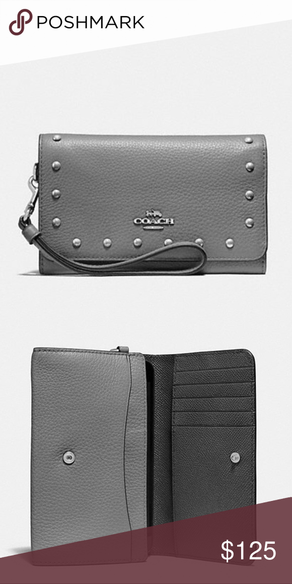 514d9e857 Flap Phone Wallet with Lacquer Rivets Style F39180. Refined pebble leather.  Eight credit card slots. Inside open pocket. Snap closure. Outside zip  pocket.