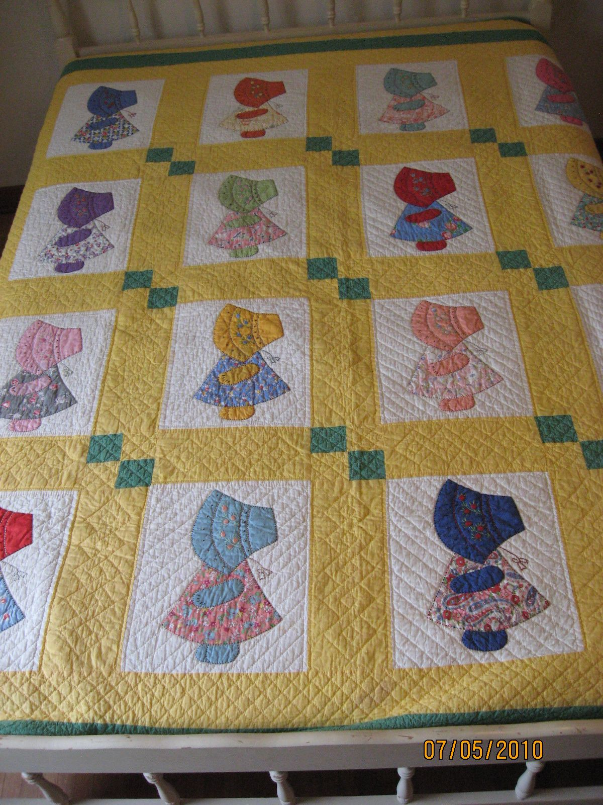 Sun Bonnet Sue made by my Grandma in 1956.  I'm amazed how often people repin this quilt.  Grammie would have been so thrilled to know how much her work was appreciated. #sunbonnetsue