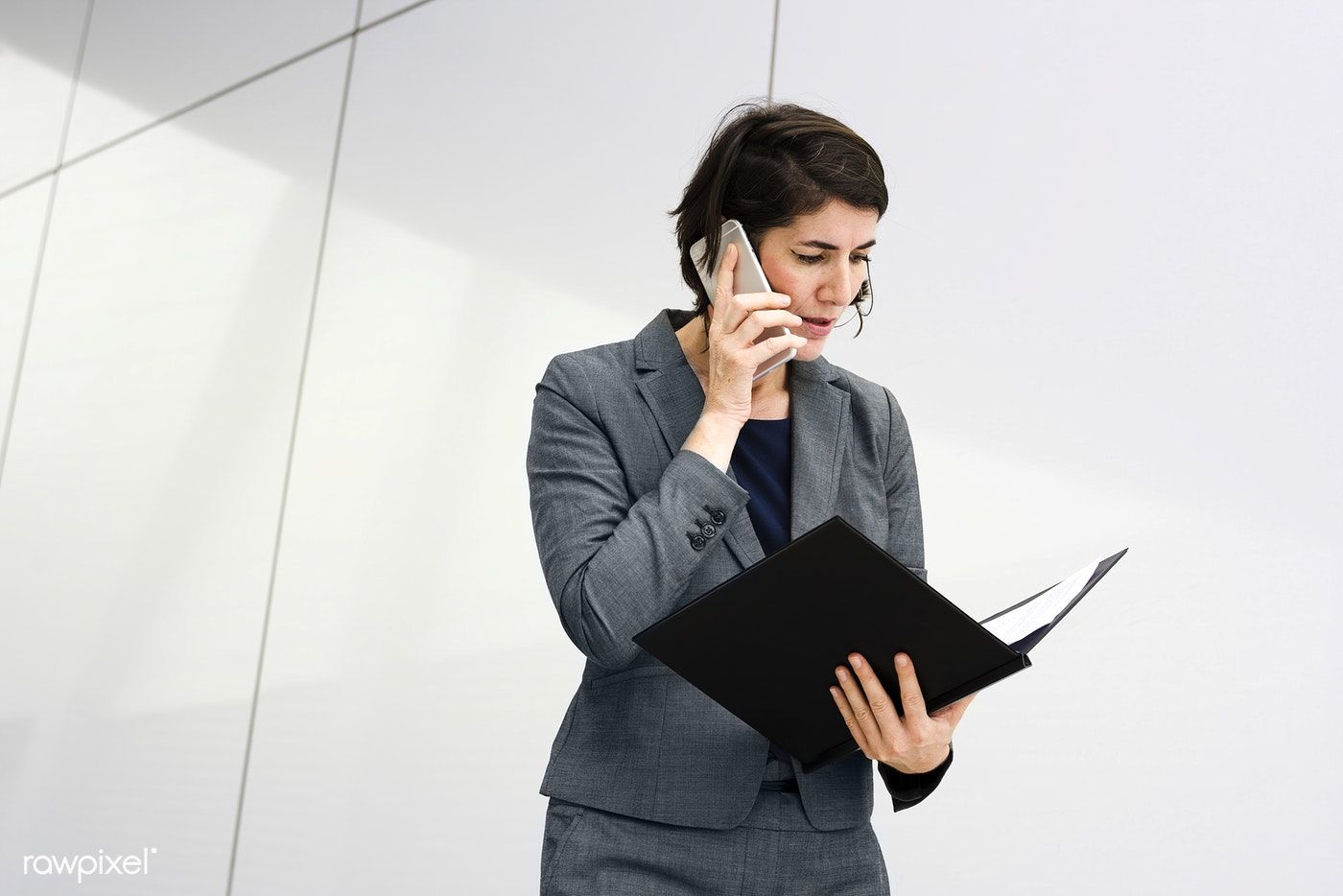Download premium image of businesswoman talking on a phone