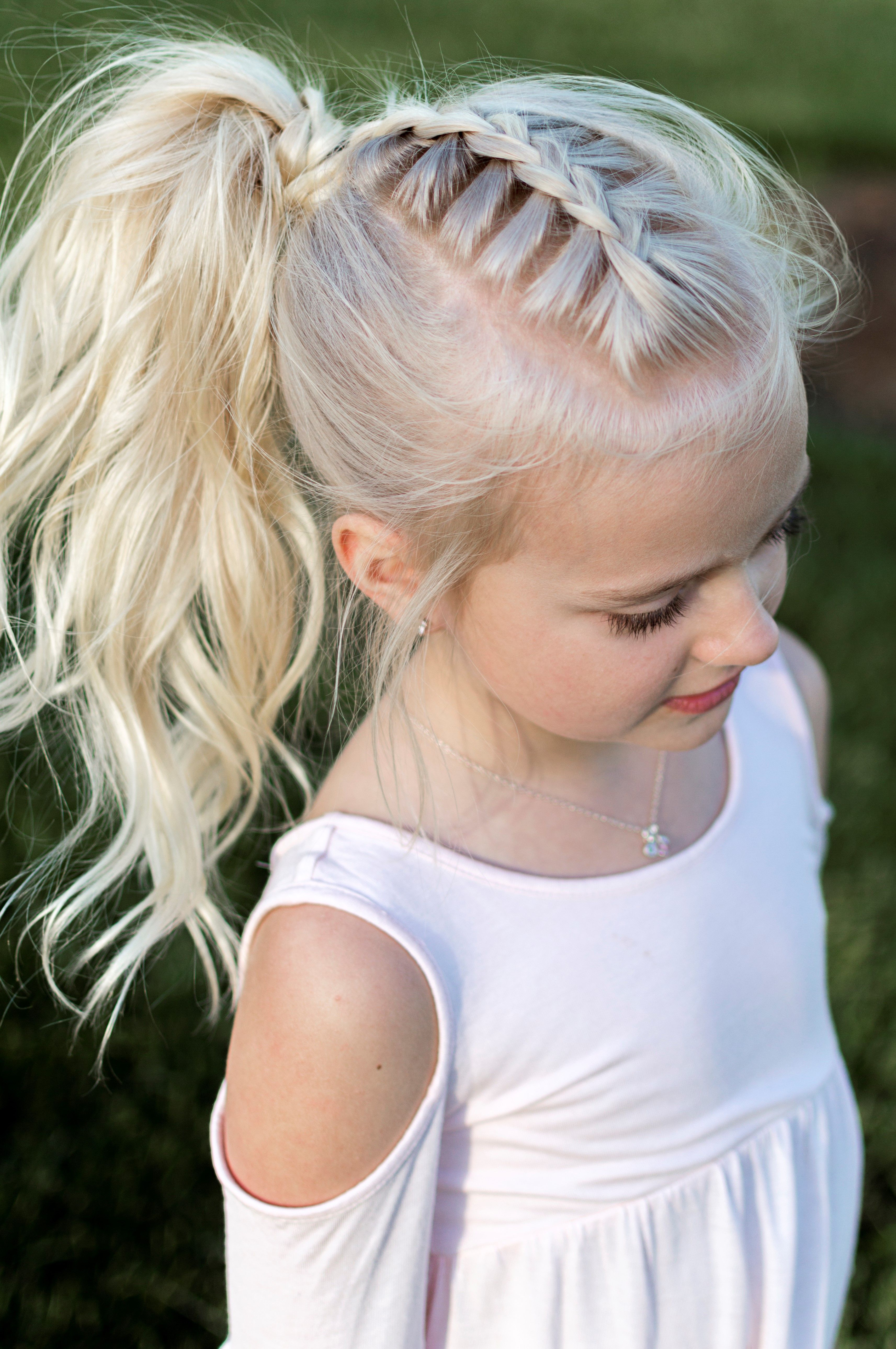 Little girl hairstyle french braid pony tail curls high pony
