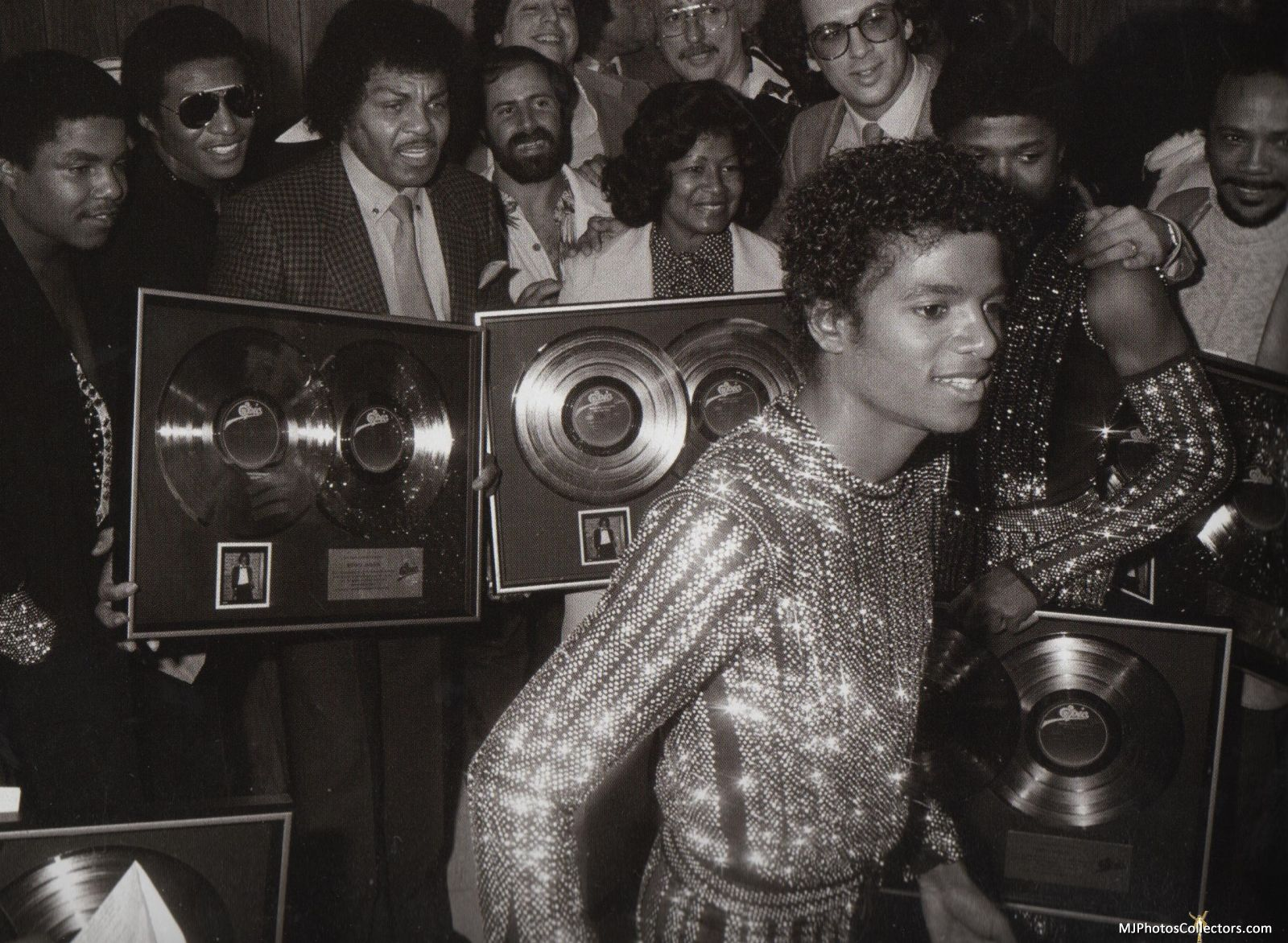 During Triumph Tour, Michael's album Off The Wall is awarded for record sales