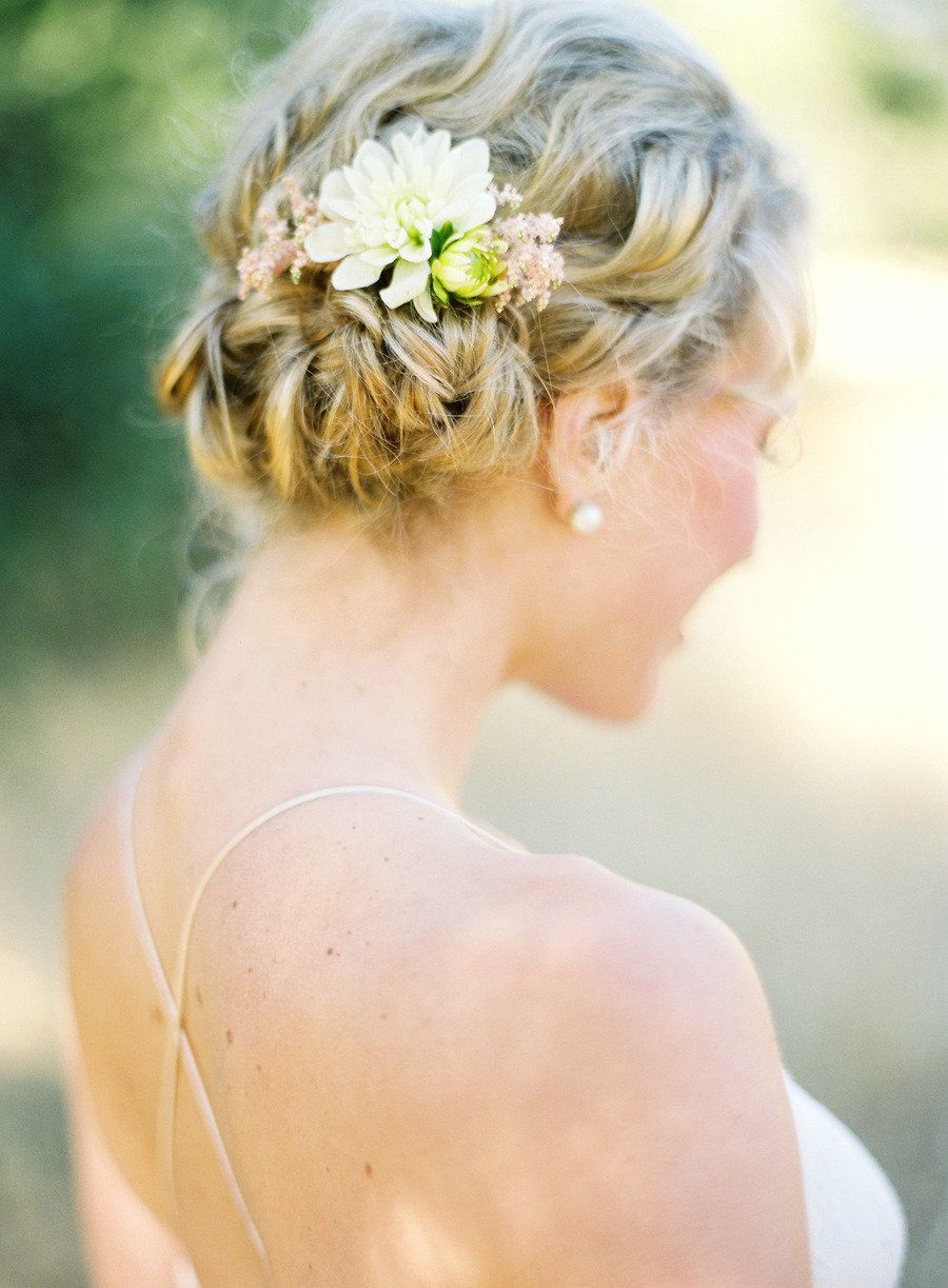 With a sweet, dainty flower: http://www.stylemepretty.com/collection/2529/