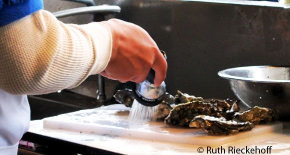 Cleaning oysters, Fisherman's Wharf, San Francisco, California