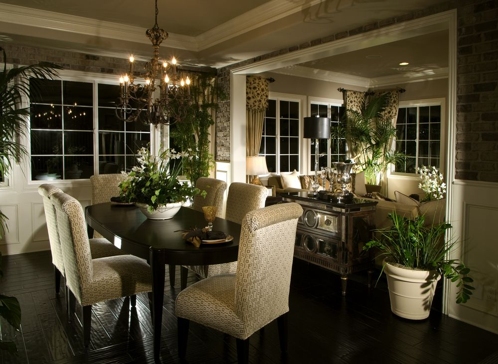 Dining Room E That Opens Up To Living Dark Wood Floors Match The Oval Table Seats Six People Plants Are Placed Throughout
