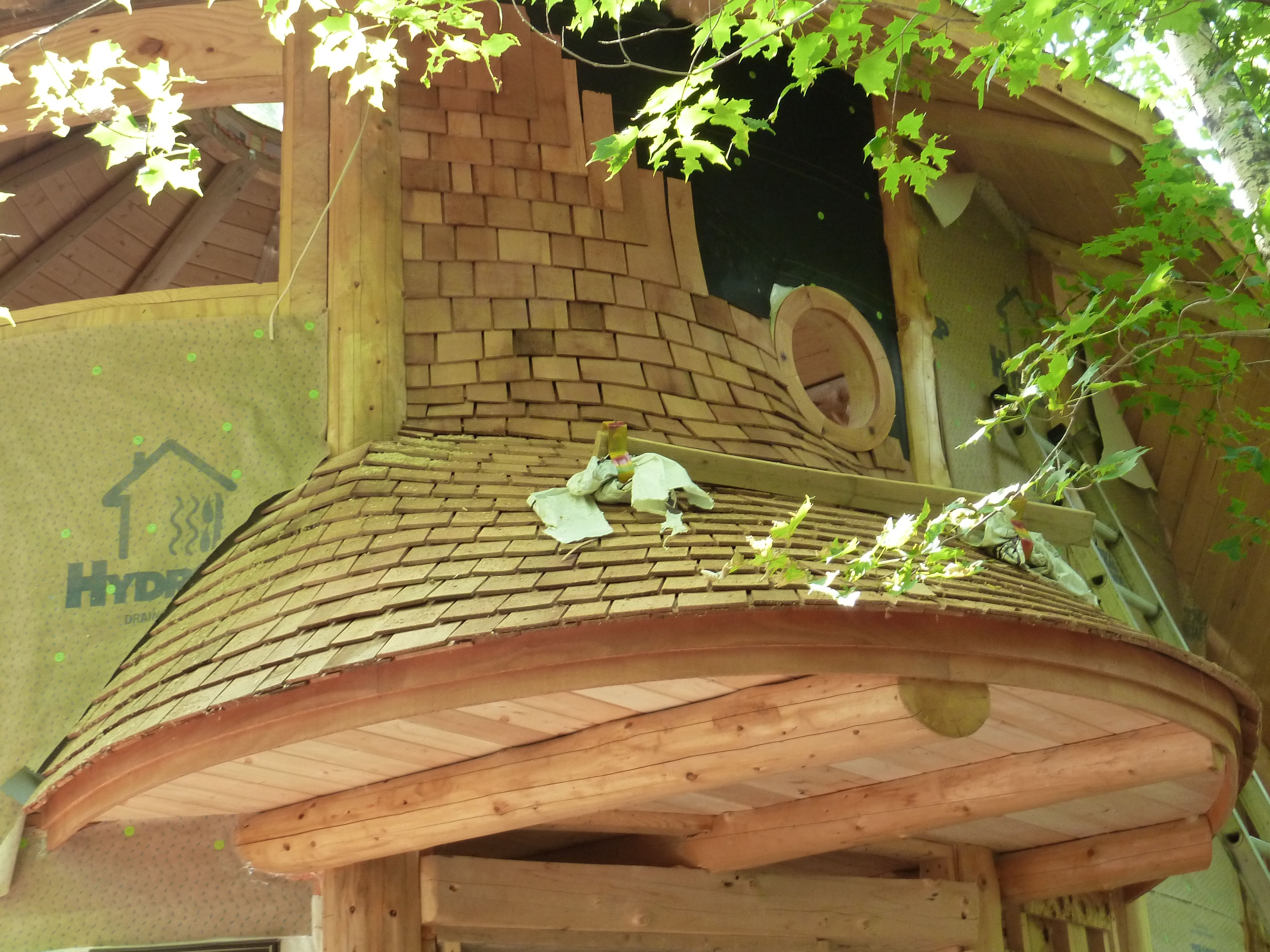 Round Curved Roof With Cedar Shingles And Round Window Round