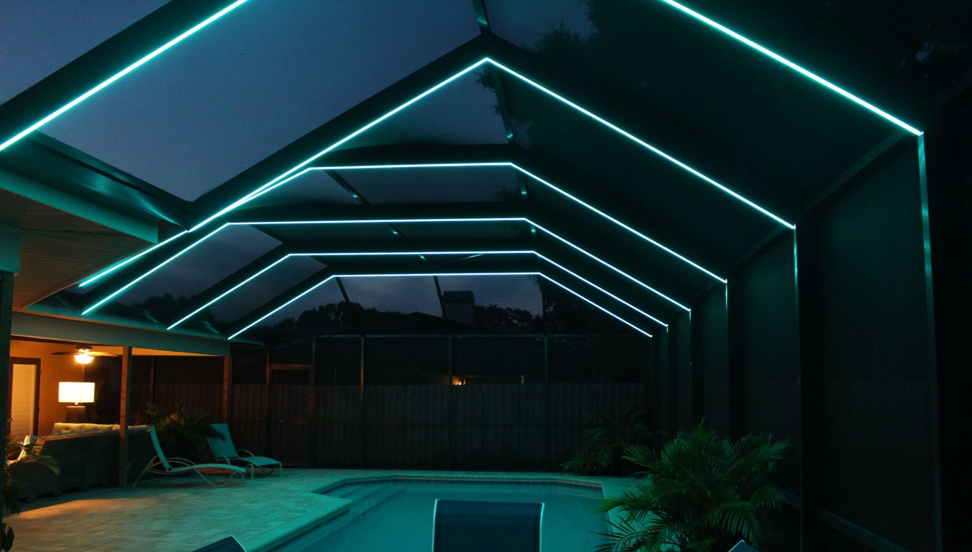 Light Up Your Florida Pool Enclosure With Any Color You Can Imagine White Or Bronze Aluminum Fixtures Are Florida Pool Pool Enclosure Lighting Pool Enclosures