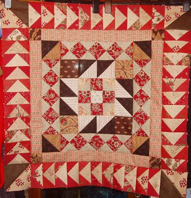 sashiko and other stitching: Red and Brown medallion quilt - an update