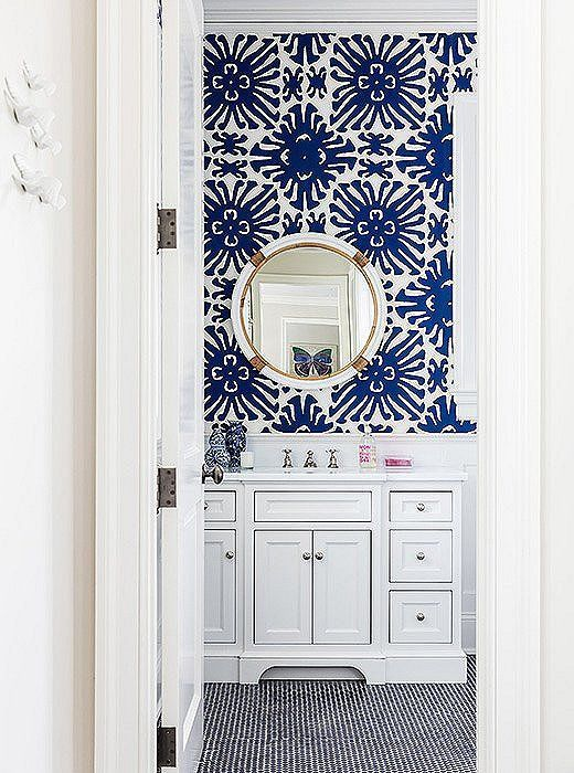 Bold Blue And White Bathroom With Coordinating Colors Of Penny Tiles And Patterned Wallpaper