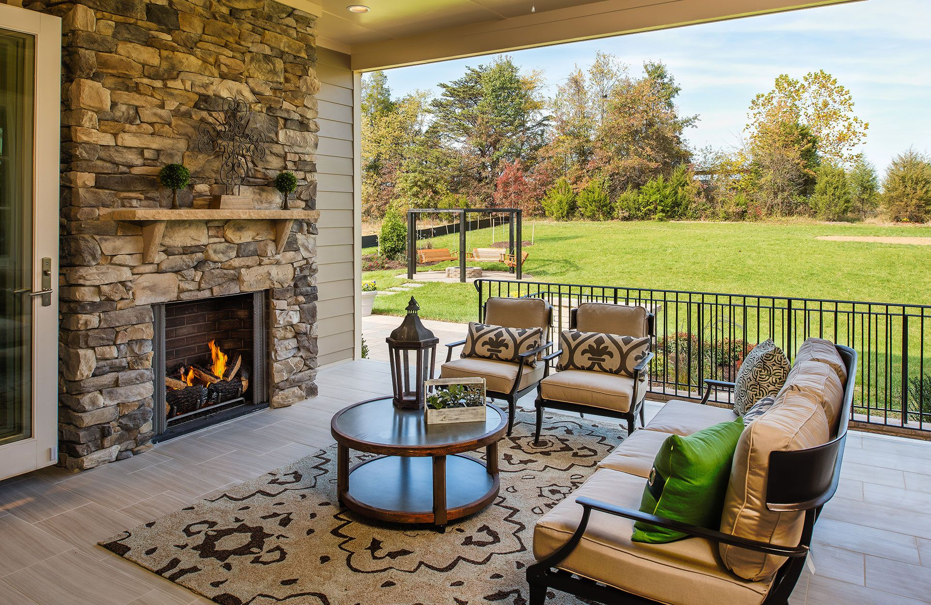 drees homes covered porch with fireplace opens right into the