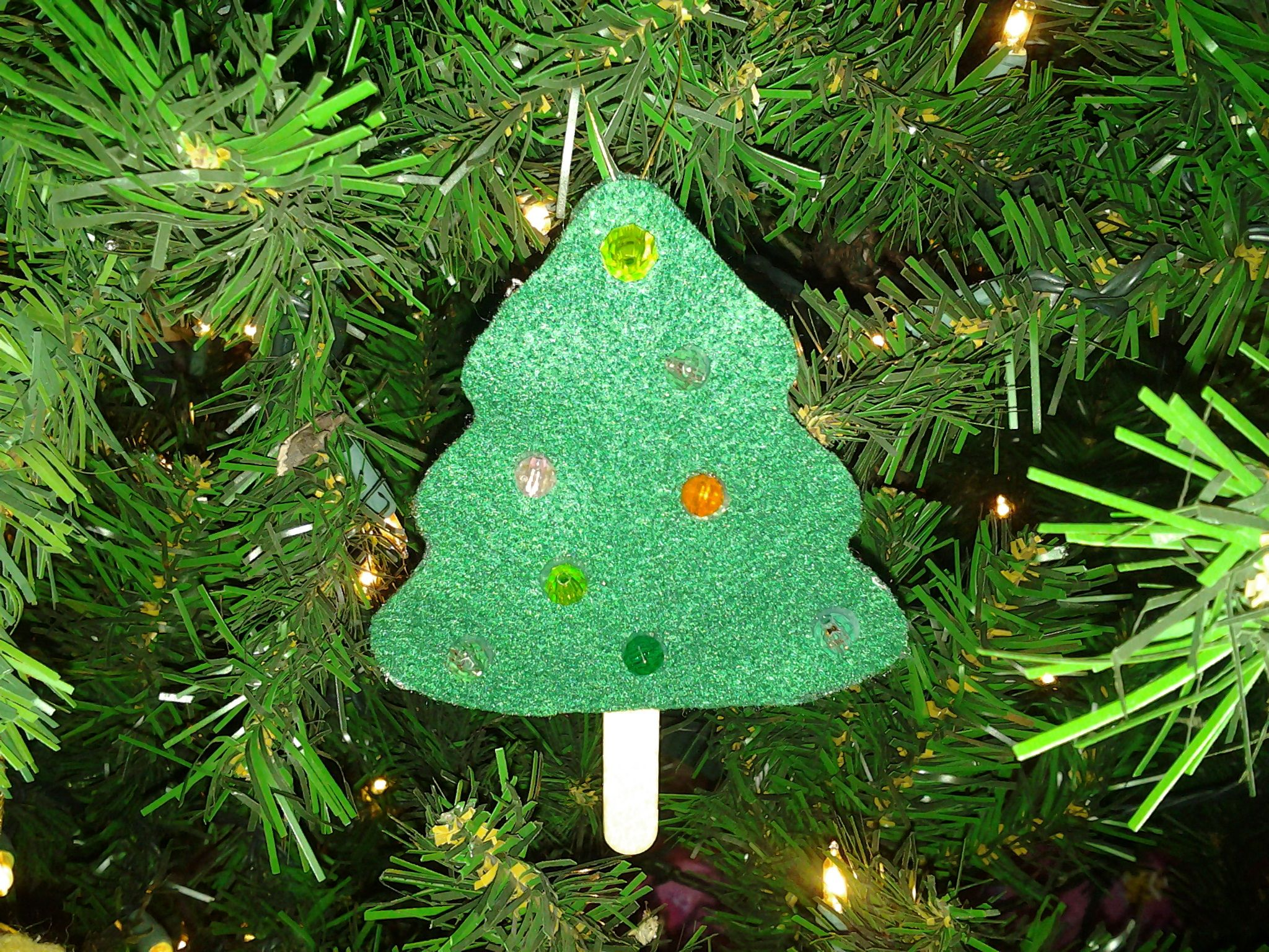 Cute felt Christmas tree.  So easy, my two year old put on the beads.