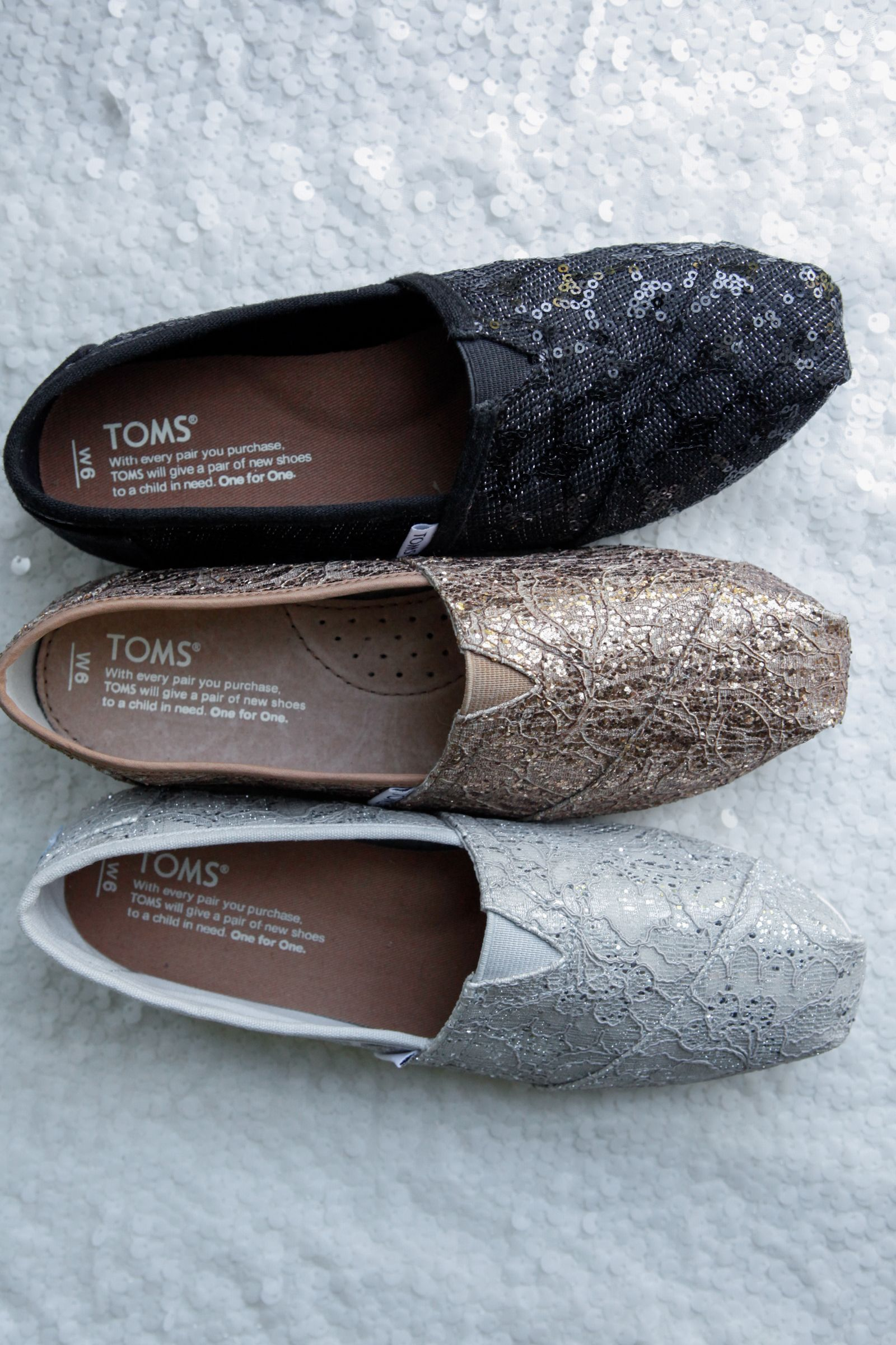 4a61666a8ec1 Sparkle all day (or night) in these vegan TOMS Classics. Each pair of shoes  features a gold, black, or silver glitzy lace pattern.
