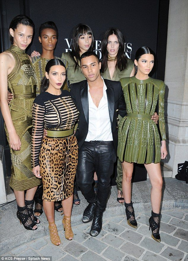 Balmain babes: Olivier was happy to be surrounded by the lovely ladies in his stunning des...