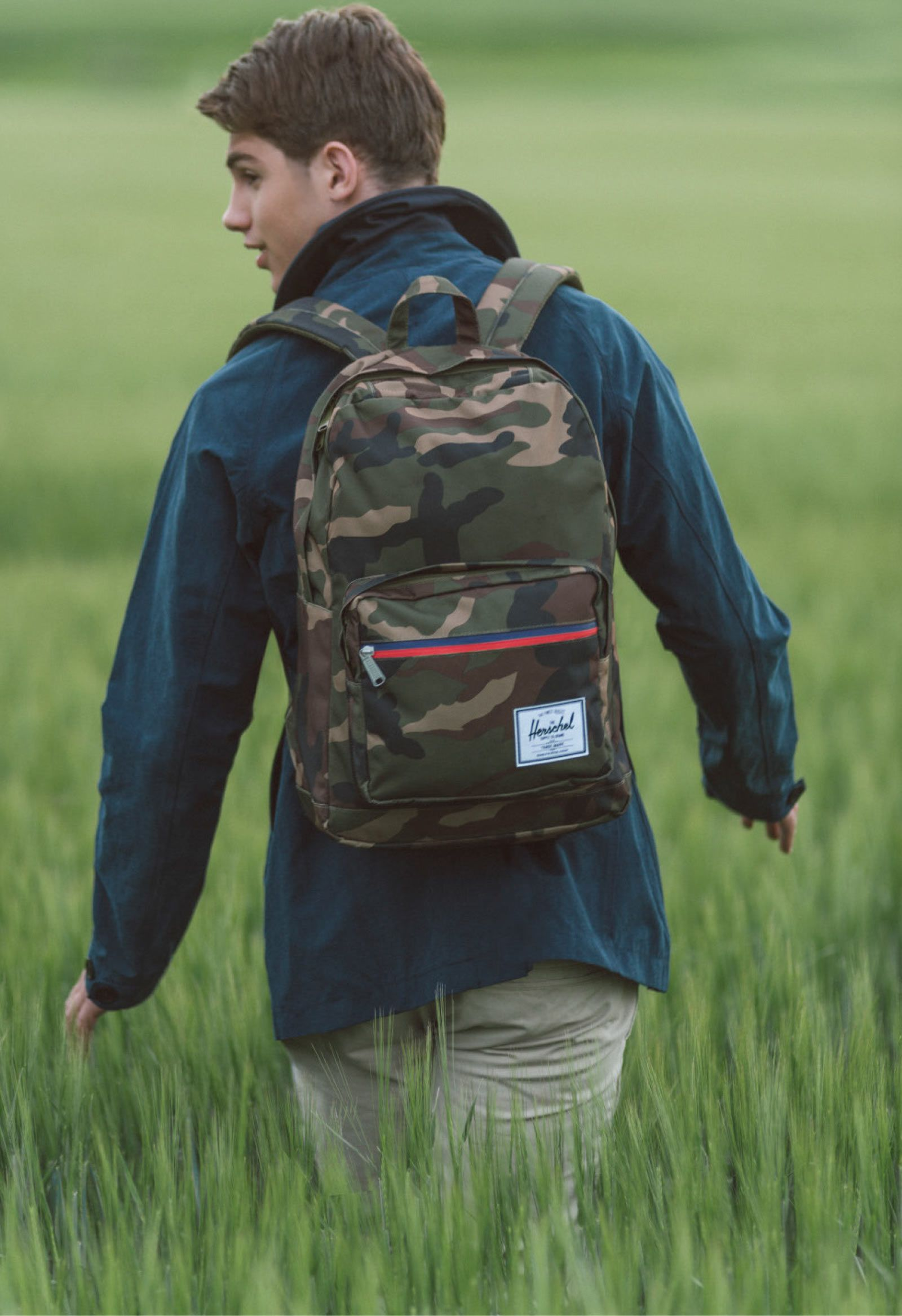 7b3c9d1cfeb Herschel Supply Pop Quiz Camo 20L Backpack Bring it all with you inside a  clean camo print design with a red and blue waterproof zipper front pouch  pocket ...