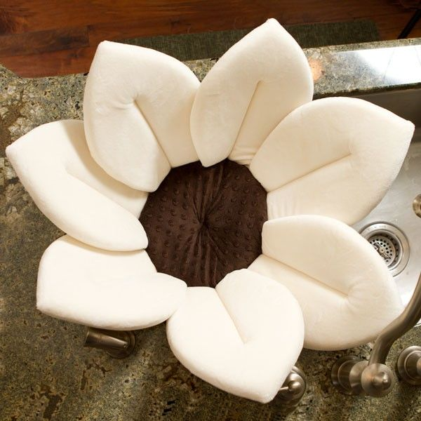 Just bought this for Bry! She's going to love her snuggly little sink baths!   The new Blooming Bath Ivory. If you're interested...get one now! free shipping for their 1 yr anniversary! Congrats to Blooming Bath and your rockin product!