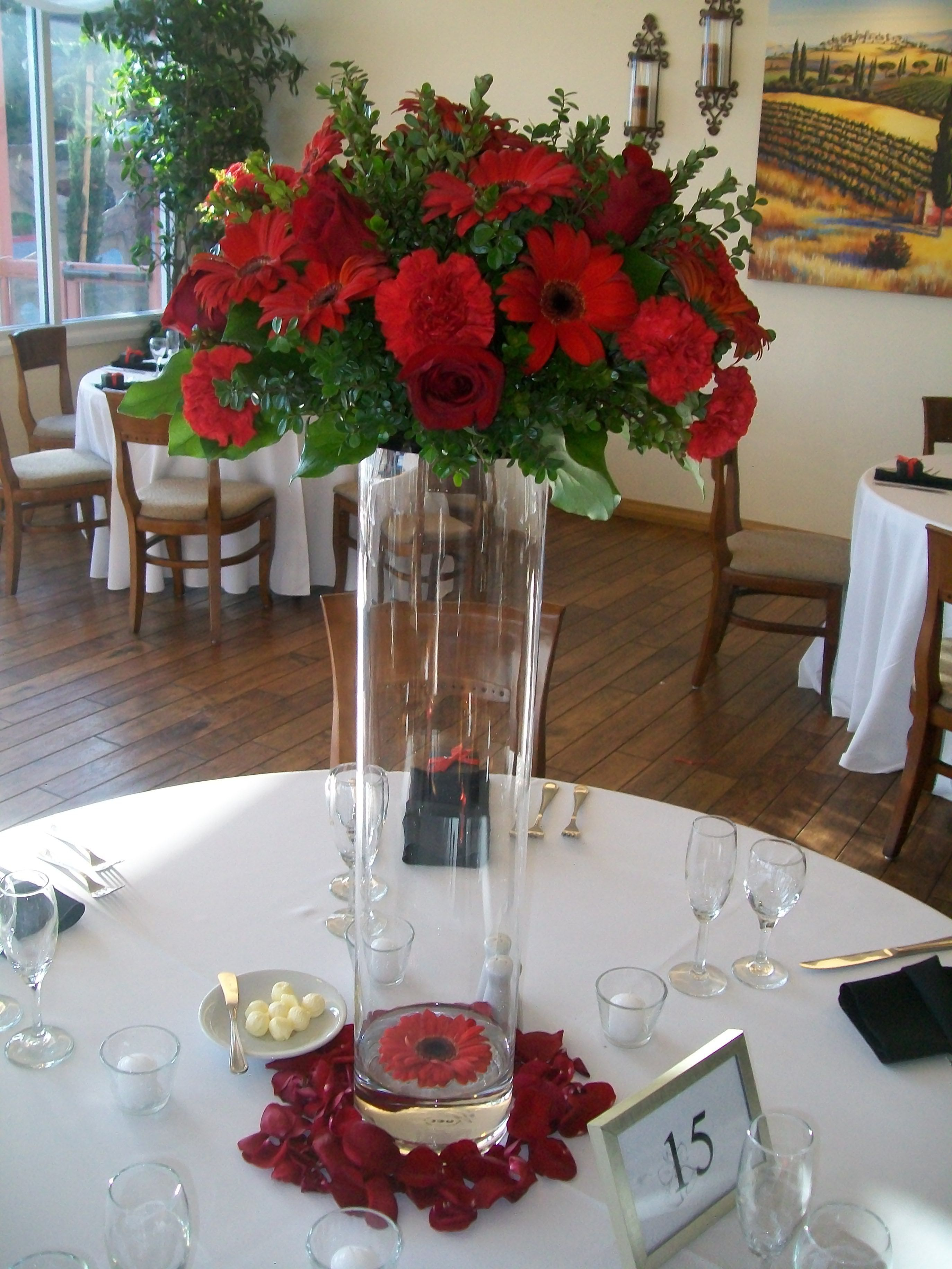 Tall Red Floral Centerpiece With A Floating Gerbera Daisy In