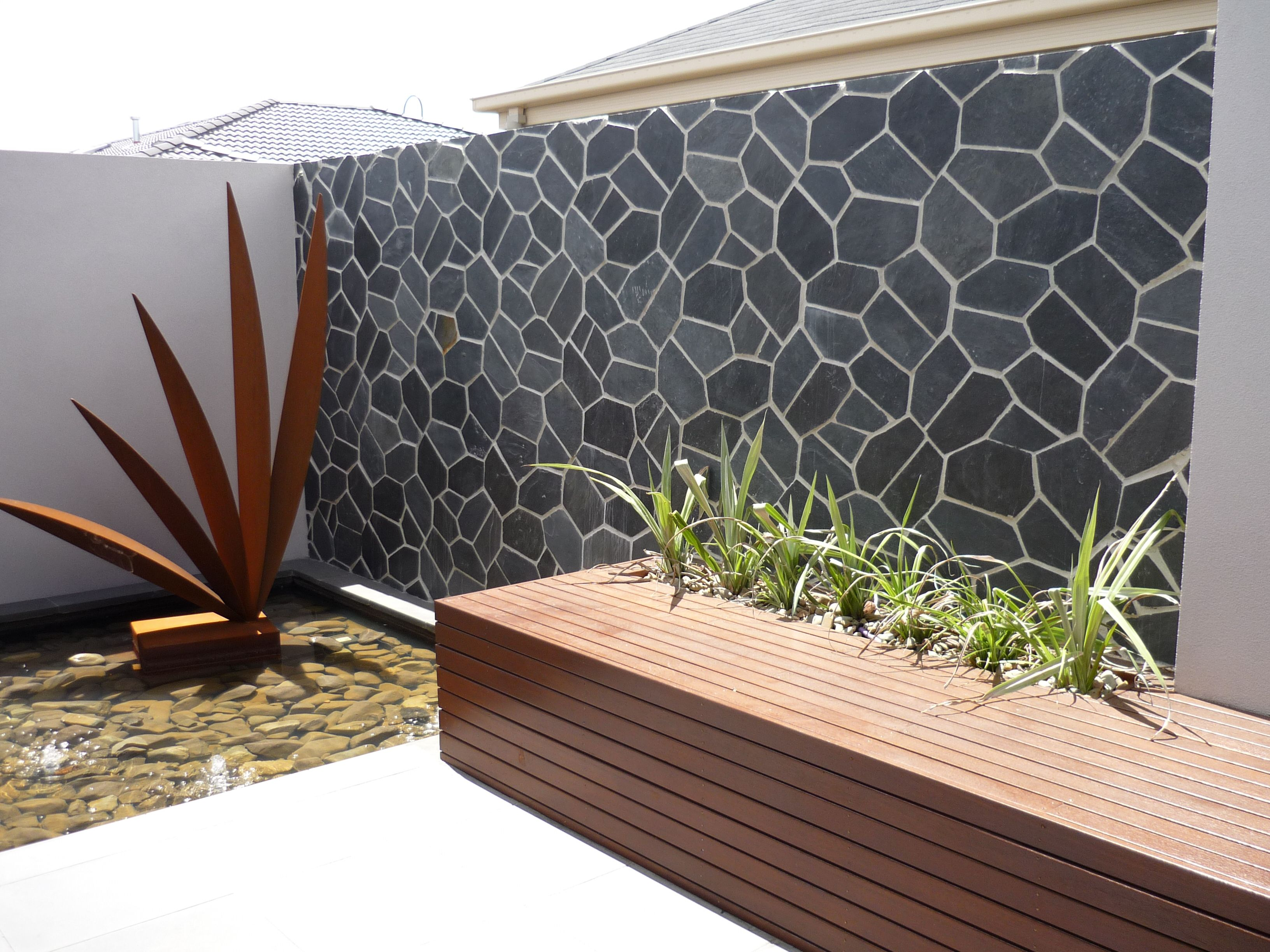 Backyard Feature Wall Ideas an outdoor feature wall in onyx. really stands out #backyard #garden