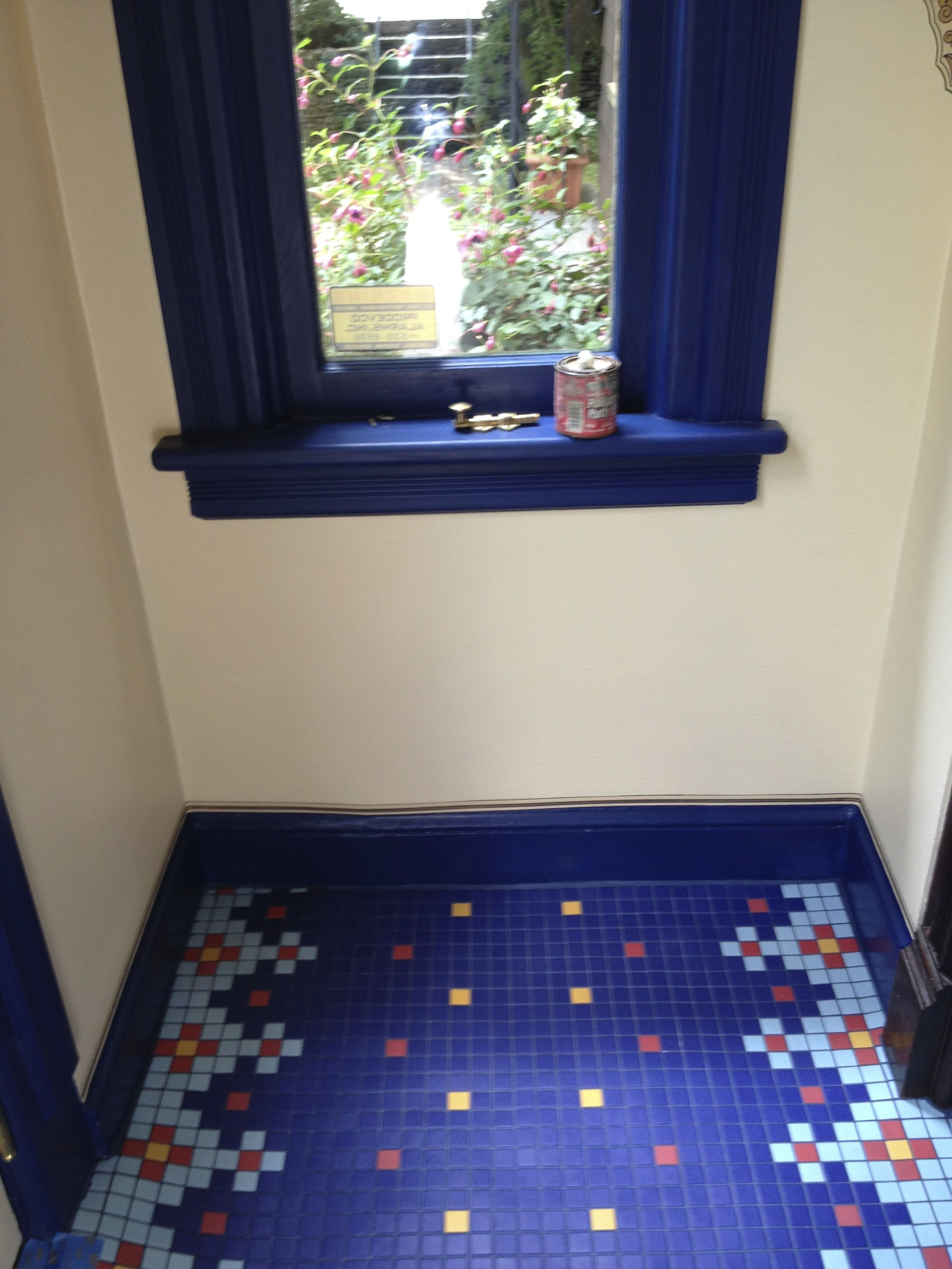 French Briare tile mosaic tile floor in the entry before the window ...