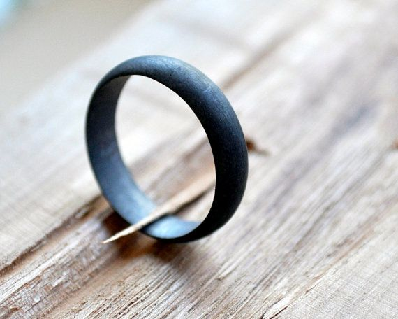 A modern masculine wedding band made from oxidized silver