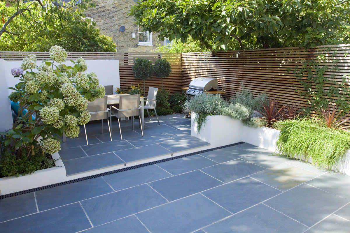 Stunning no grass garden view with granite floor shrubs for Back garden plans