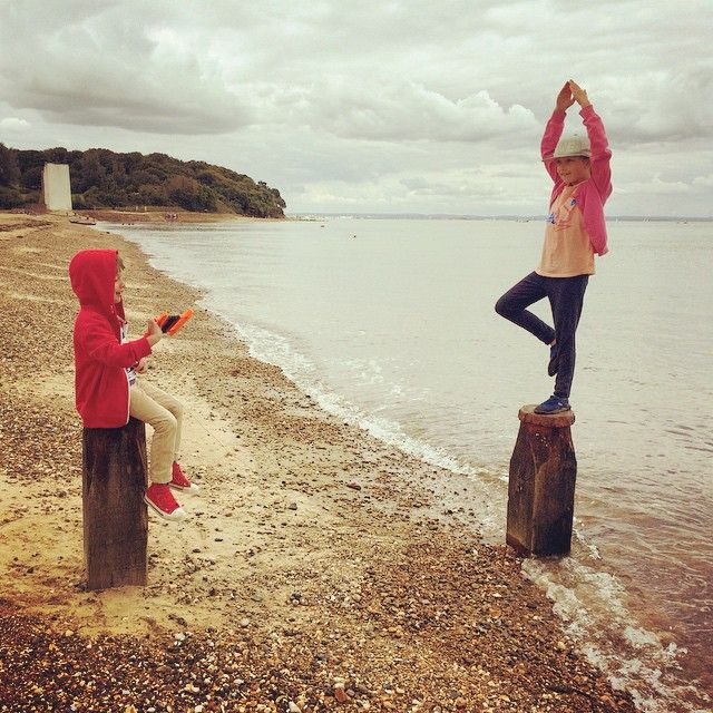 One kid #fishing one kid doing #yoga on the #beach...Sure! God love this pair  by haze82