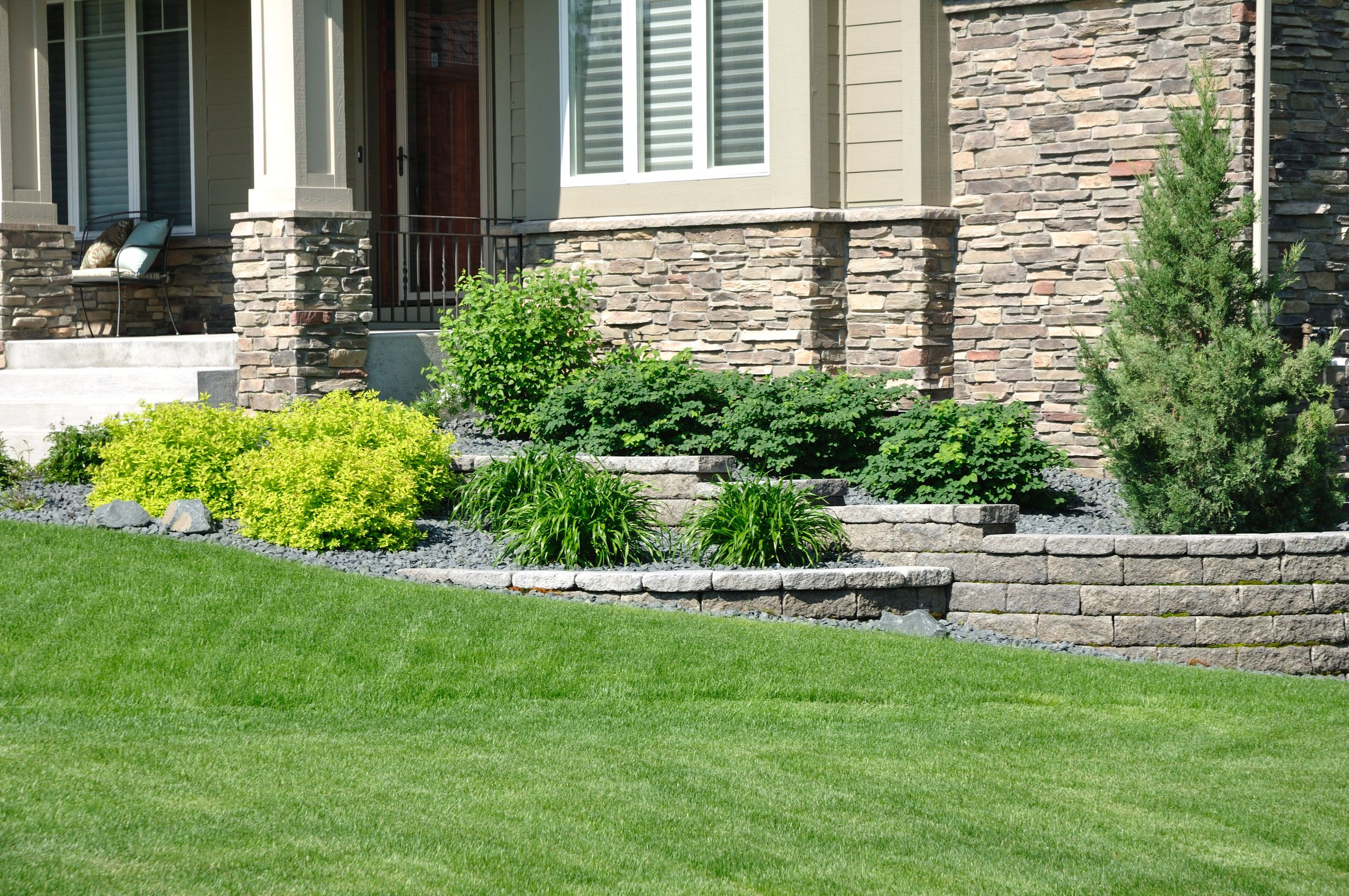 Multi Level Stone Wall With Landscaping