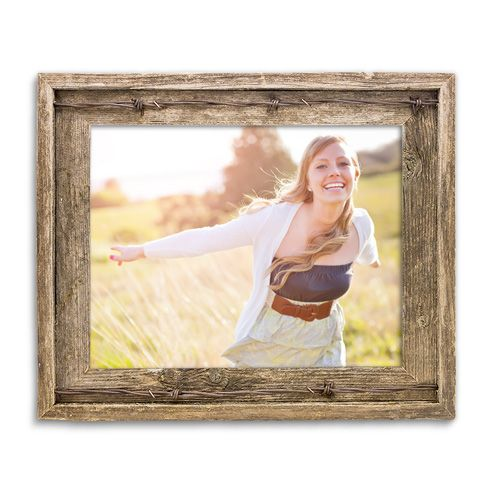 Add warmth to any room and decor with our Rustic Frame series. These frames are built from hand selected old barn siding right here in South Dakota. It features a weathered wood finish and barbed wire embellishments. These frames are fit for an array of photography or art. Includes glass and hanging hardware. Contains real barb wire. 11x14 Rustic Frame